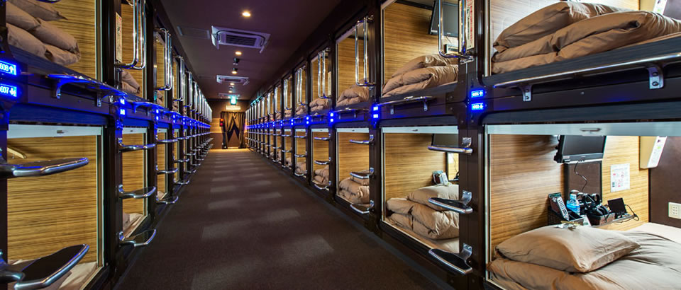 A row of capsules in the Anshin Oyado Luxury Capsule Hotel, Tokyo