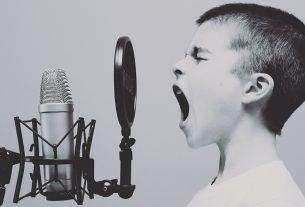 A child screams into a microphone