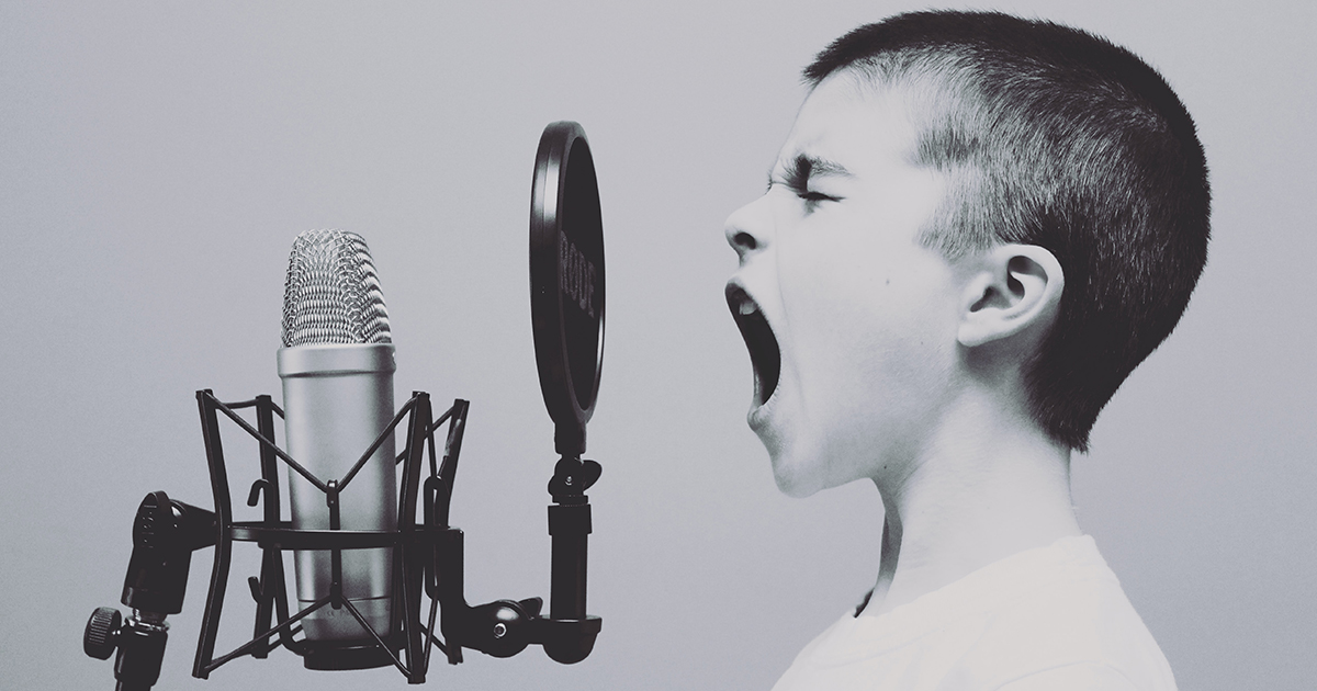 A child screams into a microphone