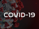 "Graphic of the virus with ""COVID-19"" text overlay"