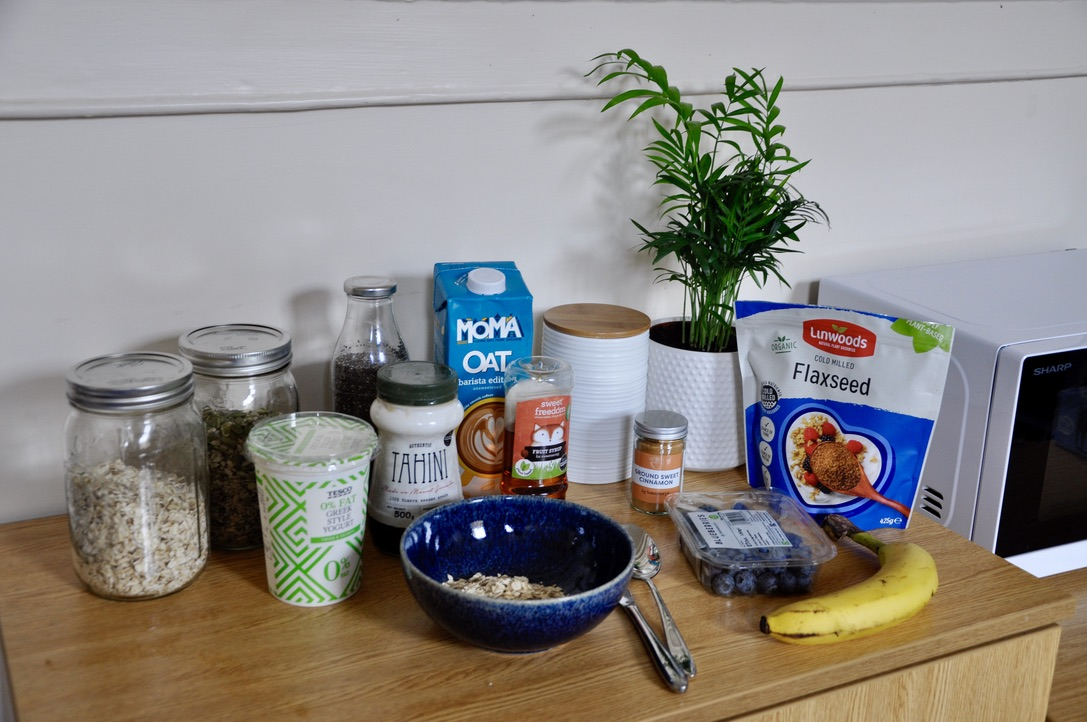 An assortment of breakfast foods next to a microwave