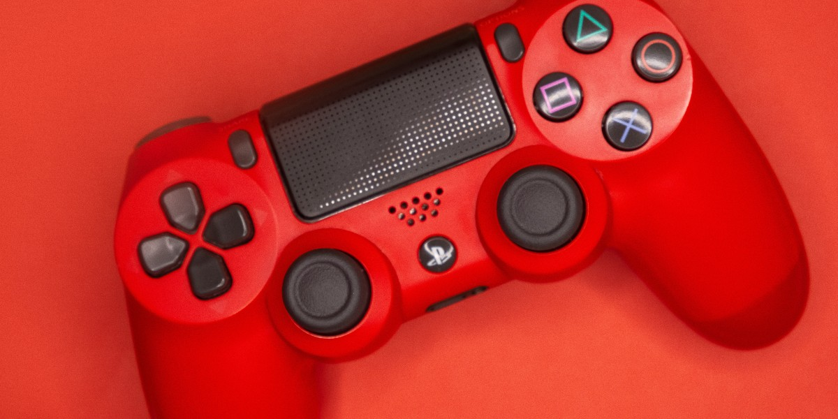 A red PlayStation 4 controller